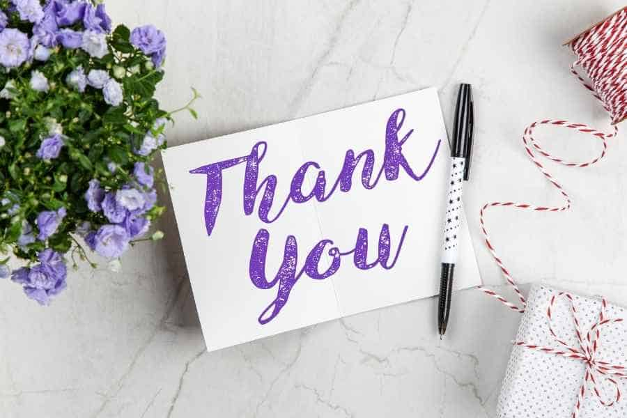 Thank you written across a card