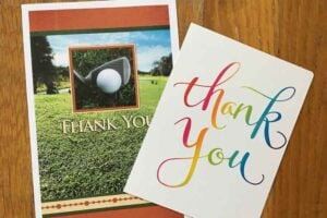 two thank you cards stacked. Left cards is golf themed. Right cards is Thank You with the letters in different colors.