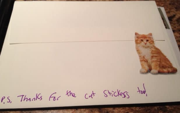 PS on back of envelope with cat sticker