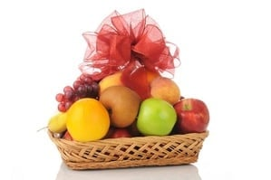 a fruit gift basket with a bow on top