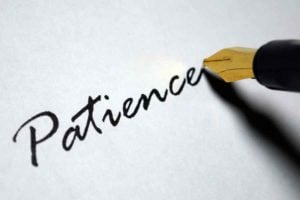 A fountain pen writing the word patience