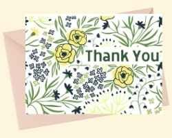 """Printable Thank You Card with floral background and the words """"Thank You"""". There are yellow flowers and green stems."""