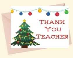 Image showing the front of a printable card with Thank You Teacher on the right, and a Christmas tree on the left. Christmas bulbs are draped across the top of the card.