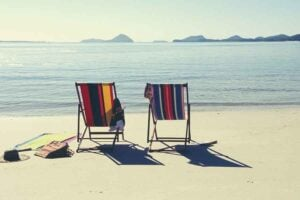 two empty beach chairs on a beach